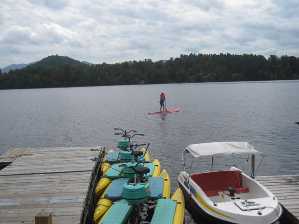 Stand up paddleboarding on Mirror Lake in Lake Placid.