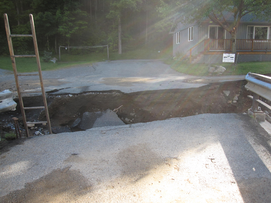 hurricane irene keene ny hole in road