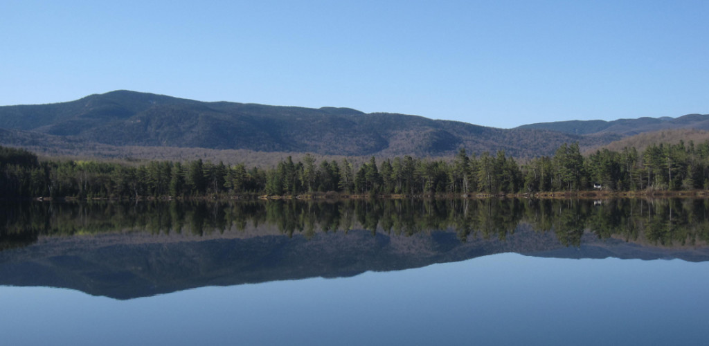 Adirondack Mountains reflected in Round Lake